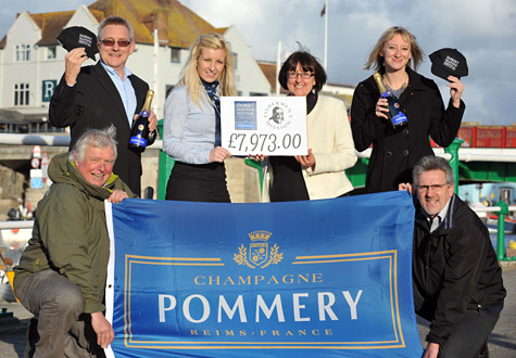 Dorset Seafood Festival present cheque to The Fishermen's Mission